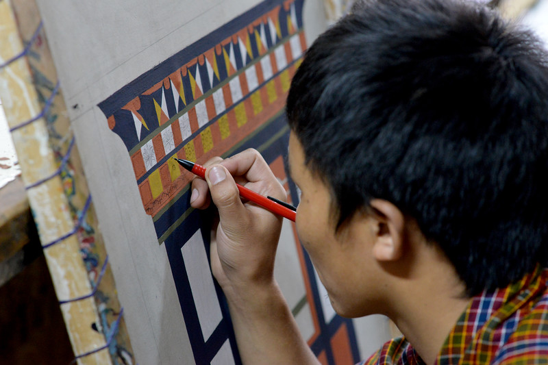 Students at the National Institute for Zorig Chusum, Dept of Human Resources, Thimphu, Bhutan.<br /> <br /> Commonly known as 'the painting school', four to six-year courses provide instruction in Bhutan's 13 traditional arts and students specialise in painting (furniture, thangka – painted religious pictures, usually on canvas), woodcarving (masks, statues, bowls), embroidery (hangings, boots, clothes) or statue-making (clay).