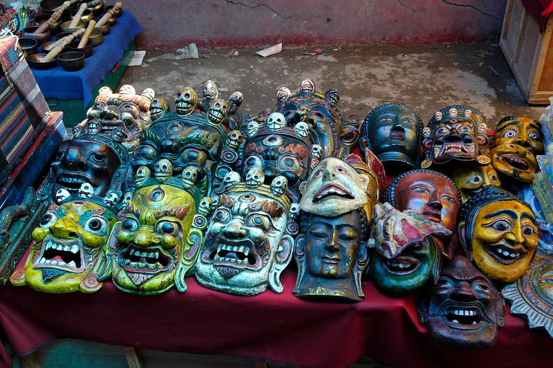 Shops selling various masks and other items at the local bazaar in Thimphu, Bhutan selling assorted items.