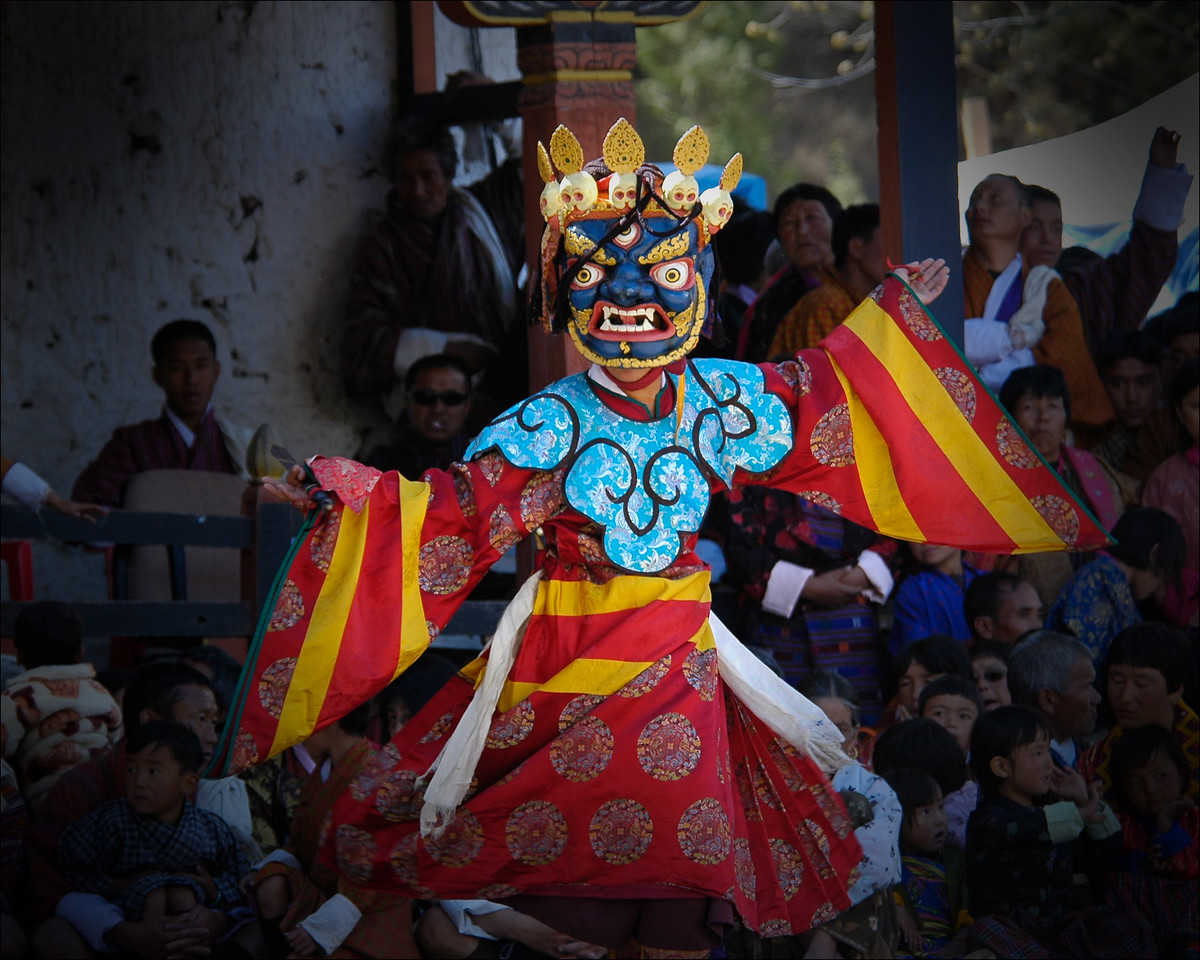 Dancers perform at the masked dance event at the Paro Tsechu Festival of Dance held in Paro, Bhutan. This is the biggest and most spectacular Buddhist festival celebration.