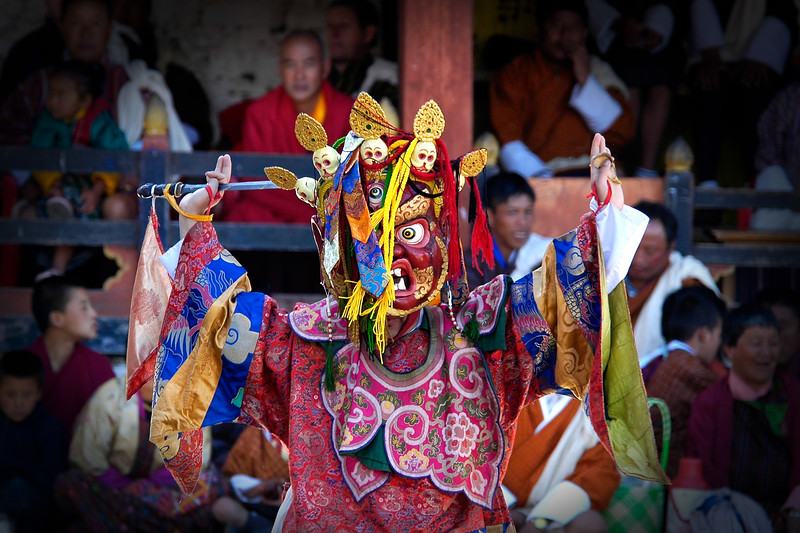 "Masked dance at the Paro Tsechu Festival of Dance held in Paro, Bhutan. This is the biggest and most spectacular Buddhist festival celebration.<br />  <br /> The Paro Tshechu festival honors Guru Padmasambhava, ""one who was born from a lotus flower."" This Indian saint contributed enormously to the diffusion of Tantric Buddhism in the Himalayan regions of Tibet, Nepal, Bhutan etc. The biography of Guru is highlighted by 12 episodes of the model of the Buddha Shakyamuni's life. Each episode is commemorated around the year on the 10th day of the month by ""the Tshechu.""<br />  <br /> During Tshechu, the dances are performed by monks as well as by laymen. The Tshechu is a religious festival and by attending it, it is believed one gains merits. It is also a yearly social gathering where the people, dressed in all their finery, come together to rejoice."