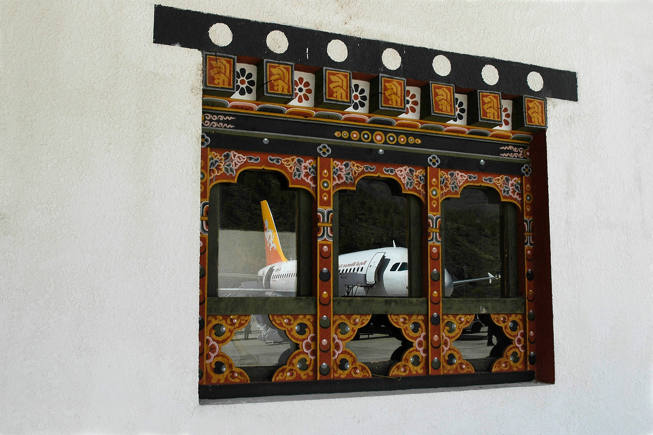 Drukair as seen in the window at Paro Airport, Bhutan. This is the single airport that the country has.