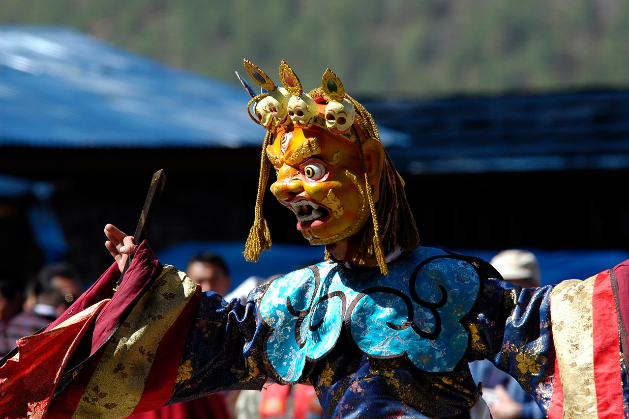 """Masked dance at the Paro Tsechu Festival of Dance held in Paro, Bhutan. This is the biggest and most spectacular Buddhist festival celebration.<br /> <br /> The Paro Tshechu festival honors Guru Padmasambhava, """"one who was born from a lotus flower."""" This Indian saint contributed enormously to the diffusion of Tantric Buddhism in the Himalayan regions of Tibet, Nepal, Bhutan etc. The biography of Guru is highlighted by 12 episodes of the model of the Buddha Shakyamuni's life. Each episode is commemorated around the year on the 10th day of the month by """"the Tshechu.""""<br /> <br /> During Tshechu, the dances are performed by monks as well as by laymen. The Tshechu is a religious festival and by attending it, it is believed one gains merits. It is also a yearly social gathering where the people, dressed in all their finery, come together to rejoice."""