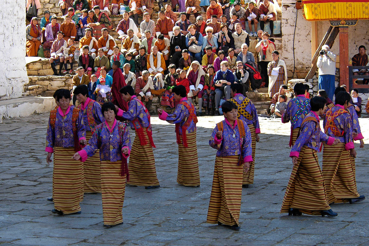Women sing and dance at the Paro Tsechu Festival of Dance held in Paro, Bhutan. This is the biggest and most spectacular Buddhist festival celebration.