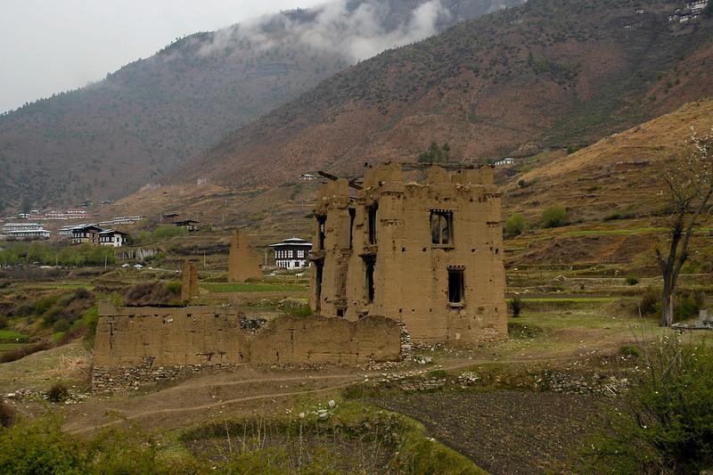 Old unused mud house seen on the drive between Thimphu and Paro, Bhutan