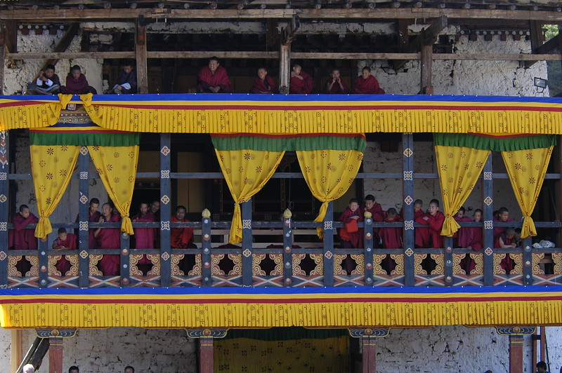 Monks viewing the Paro Tsechu Festival of Dance held in Paro, Bhutan.