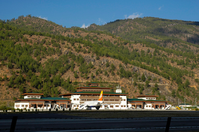 Paro - the city with the one and only airport in Bhutan. The land of the dragons. Seen in the image is one of the Drukair airbus aircrafts.