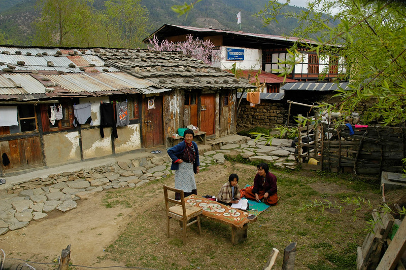 Studying in the open area of the house in a typical home in Thimphu, the capital of Bhutan.