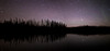 Tree silhouettes and stars at night, Blue Lakes, Northern British Columbia.
