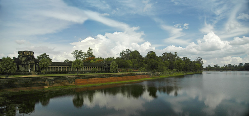 Panoramic image of Angkor Wat Temple Complex at Siem Reap, Cambodia.<br />  Angkor Wat (or Angkor Vat) is a temple complex at Angkor, Cambodia, built for King Suryavarman II in the early 12th century as his state temple and capital city. As the best-preserved temple at the site, it is the only one to have remained a significant religious centre since its foundation—first Hindu, dedicated to Vishnu, then Buddhist. The temple is the epitome of the high classical style of Khmer architecture. It has become a symbol of Cambodia, appearing on its national flag, and it is the country's prime attraction for visitors.