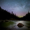 """Mountainless""  Faint Milky Way and aurora above the Mistaya River, Banff National Park, Alberta, Canada."