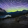 Aurora borealis and stars over the Mistaya Valley, Peyto Lake, Banff National Park, Alberta, Canada.