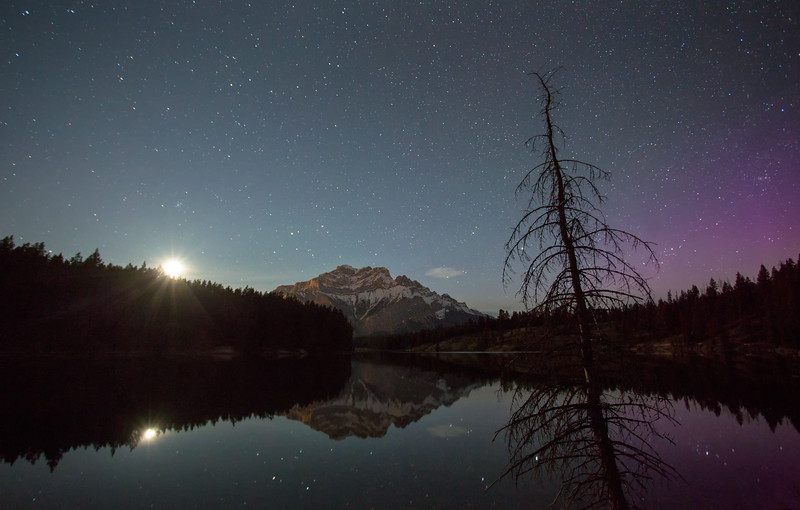 """By The Millions"" III  Moon and faint aurora over Johnson Lake, Banff National Park, Alberta, Canada."