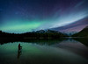 Photographer in Two Jack Lake under aurora