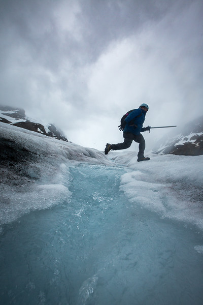 Jumping over glacier stream, Athabasca