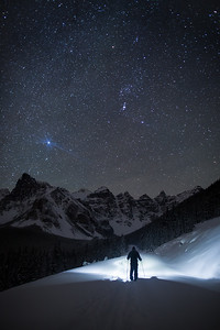 Night ski touring at frozen Moraine Lake
