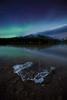 Iceberg at Two Jack Lake under aurora