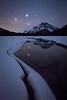 Stars reflected in melting lake, Banff National Park