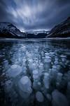 Frozen methane bubbles in Lake Minnewanka, Banff National Park