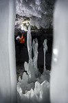 Climbing in ice Cave