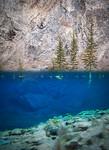 Underwater view of climbers, Banff
