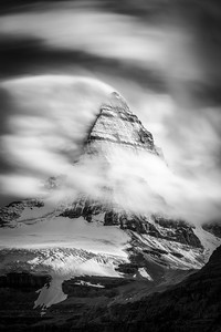 Peak of Mount Assinboine among the clouds, Mount Assinboine Provincial Park, British Columbia, Canada
