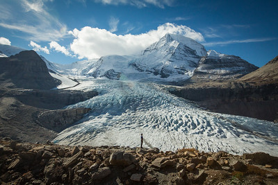 A man in front of a glacier, Mount Robson Provincial Park, British Columbia, Canada