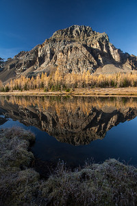 Mountain reflected in a lake, Mount Assinboine Provincial Park, British Columbia, Canada
