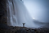 A man in front of a waterfall, Mount Robson Provincial Park, British Columbia, Canada