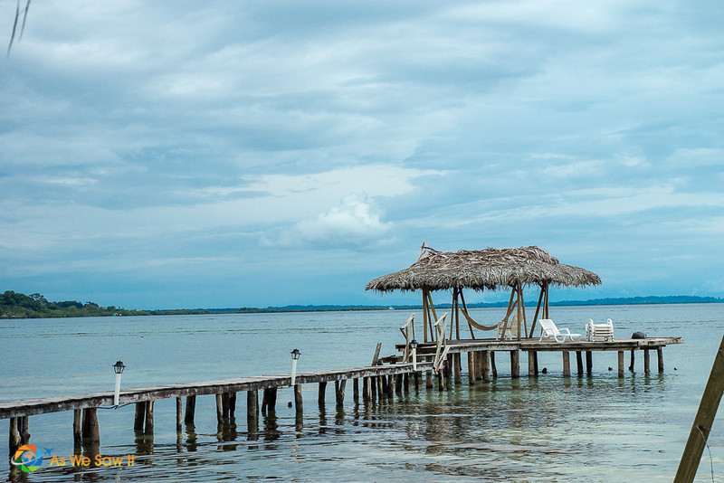 Pier onto the caribbean sea with a lounge chair and hammock in Bocas del Toro, Panama