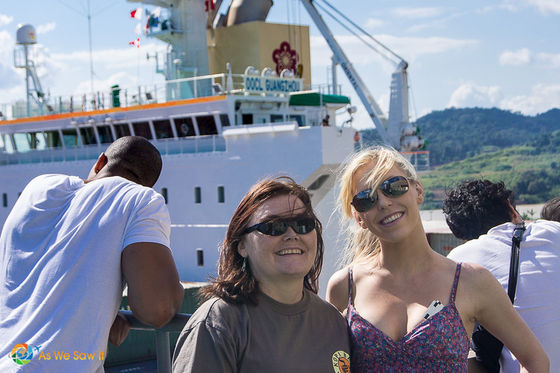 Linda and her daughter pose for a selfie in front of a ship passing through the Panama Canal