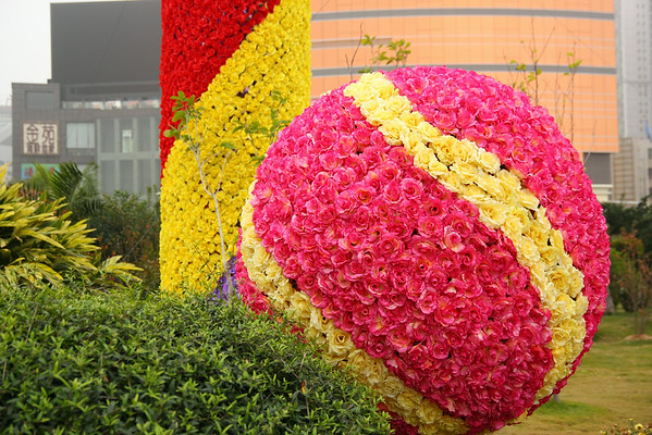 A close up of the colorful decorations reveals that they are made of imitation roses.