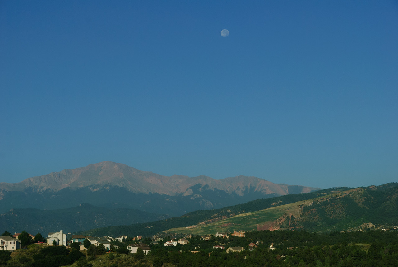 Moon setting over Pike's Peak in early morning, viewed from Colorado Springs, CO