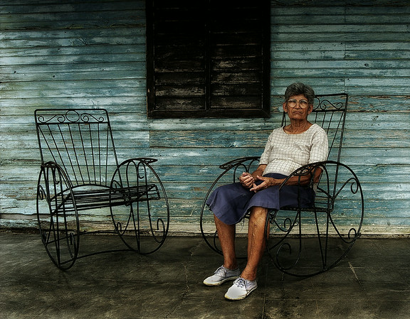 Sitting in the shade on the front porch seems to be the local pastime in Cuba. And what could be better than rocking the evenings away on a finely crafted rocking chair? Every house has at least two of these cast iron giants on their porch.   Country house, Central Cuba, 2006