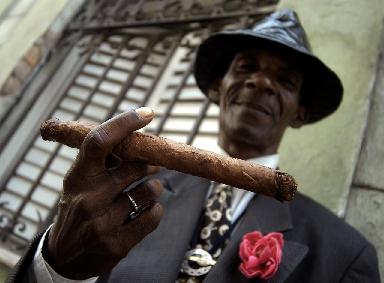 Street hustler posing for a picture in Havana. <br /> <br /> Cuba , 2006