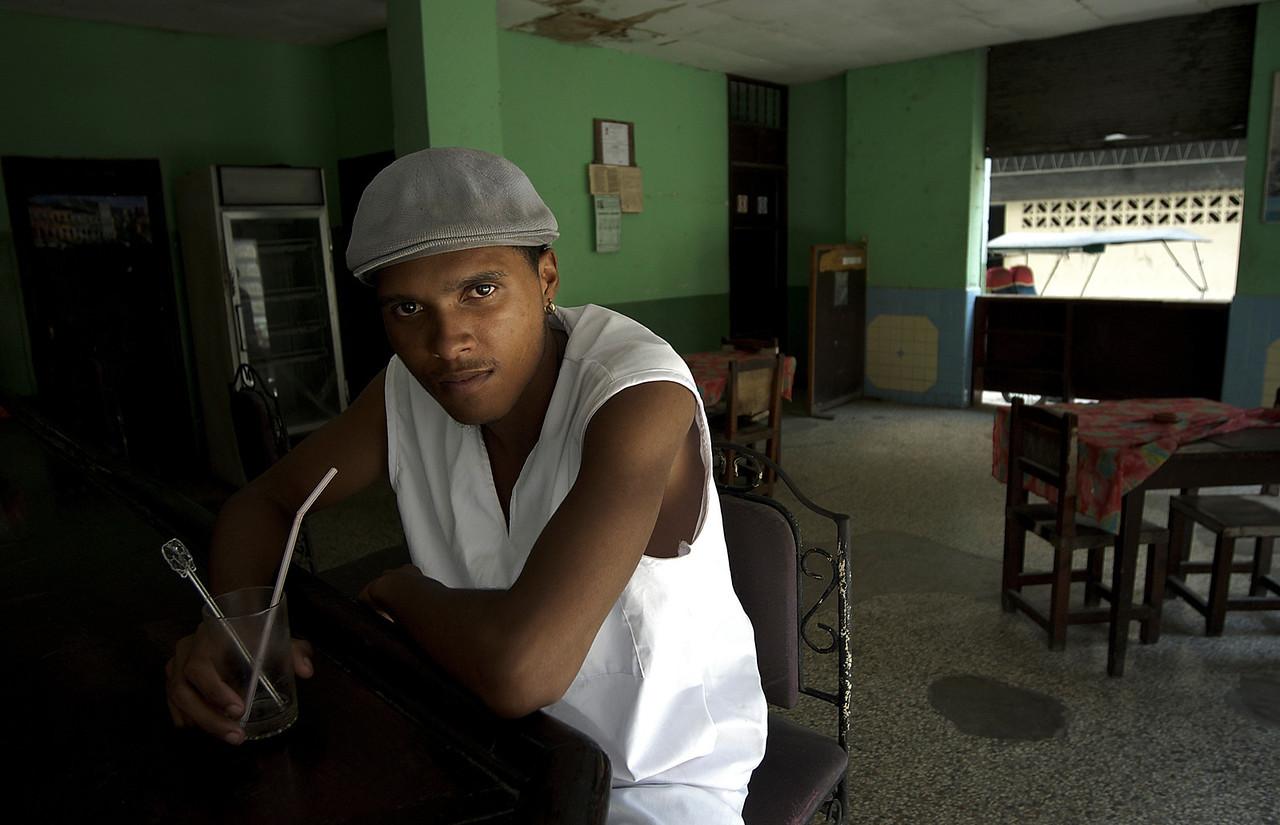Man having a mojito in a bar.<br /> <br /> Havana,Cuba , 2006