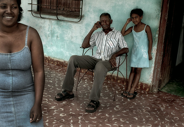 Family relaxing in the front porch,   Remedios,Cuba, 2006.