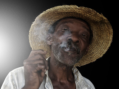 Farmer smoking a home made cigar.  Vinales, Cuba , 2006