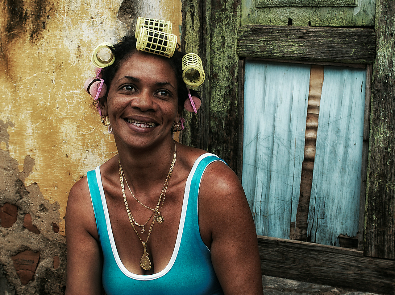 Woman drying her hair outside her home, <br /> <br /> Vinales, Cuba , 2006