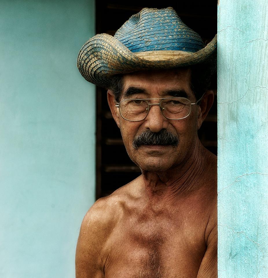 Farmer on his front porch.<br /> <br /> vinales, Cuba , 2006