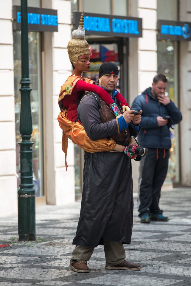 Artists and vendors alike, do their best to draw the attention of tourists in Prague, Czech Republic.