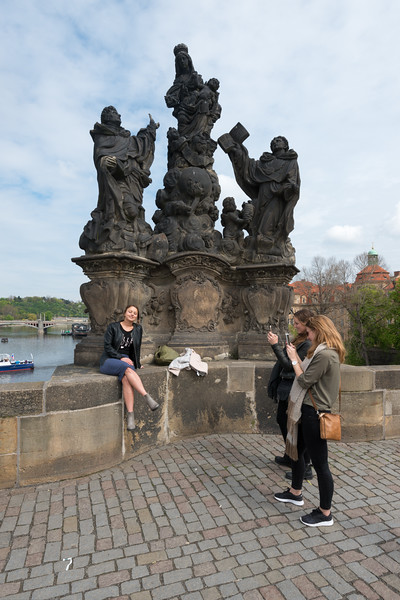 Charles Bridge, Prague, Czech Republic is a popular location for pictures and selfies.<br /> <br /> The Charles Bridge (Czech: Karlův most) is a famous historic bridge that crosses the Vltava river. Its construction started in 1357 under the auspices of King Charles IV, and finished in the beginning of the 15th century. The avenue of 30 mostly baroque statues and statuaries situated on the balustrade forms a unique connection of artistic styles with the underlying gothic bridge. They depict various saints and patron saints venerated at that time.