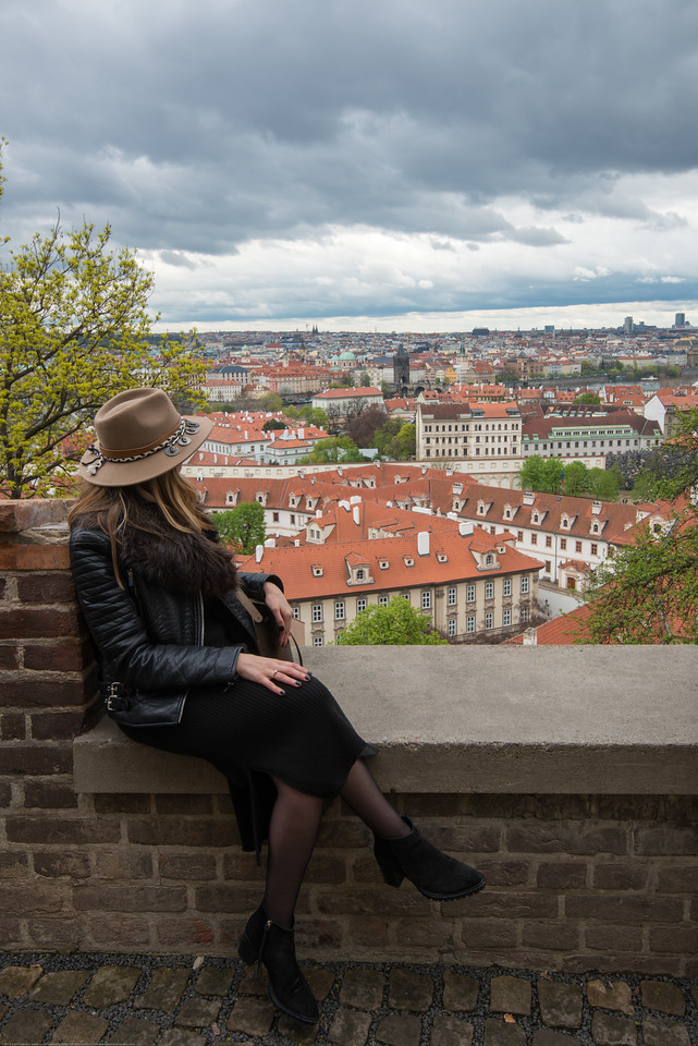 Lady with a hat at the Prague Castle viewing point, Prague, Czech Republic.