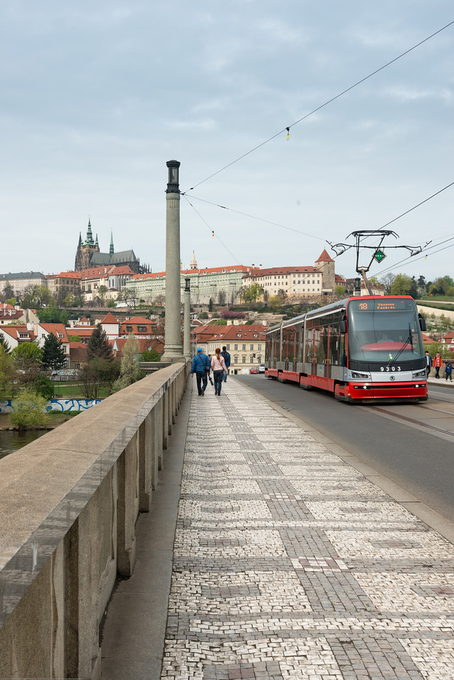 Trams and bus running on Mánesův Most (bridge) over Vltava, Prague, Czech Republic.