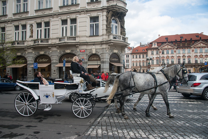 Visitors often hire horse carriages to see Old town of Prague, Czech Republic.