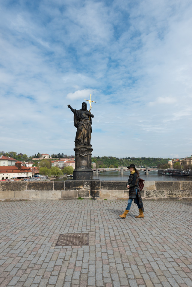 Charles Bridge, Prague, Czech Republic.<br /> The avenue of 30 mostly baroque statues and statuaries situated on the balustrade forms a unique connection of artistic styles with the underlying gothic bridge. They depict various saints and patron saints venerated at that time. The Charles Bridge (Czech: Karlův most) is a famous historic bridge that crosses the Vltava river. Its construction started in 1357 under the auspices of King Charles IV, and finished in the beginning of the 15th century.