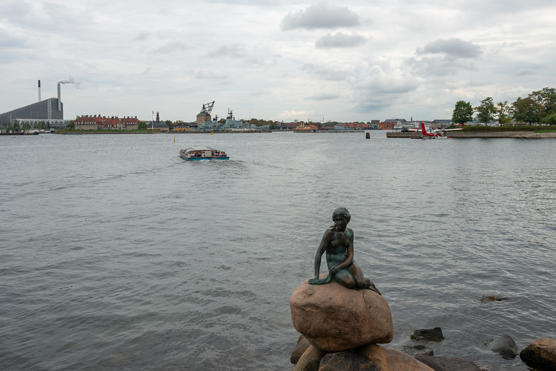Considering the hype, the little mermaid statue is quite small and unimpressive. The Little Mermaid, Den Lille Havfrue, Langelinie, København, Copenhagen, Denmark. Iconic bronze mermaid sculpture, by Edvard Eriksen, of a character from H.C. Andersen's fairytale.
