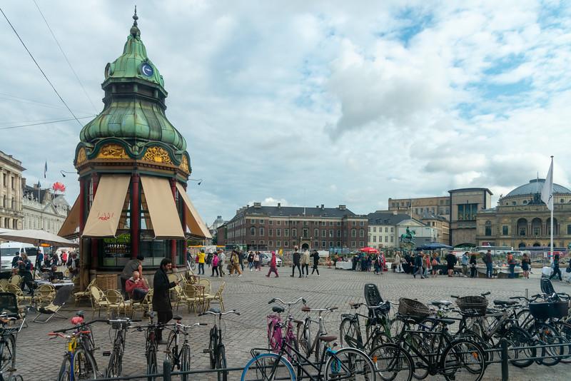 Den Gamle Telefonkiosk,  Copenhagen, København, Denmark at King's New Square (Kongens Nytorv) - landmark cobble-stoned square dating to 1907, containing a royal equestrian statue of Christian V.