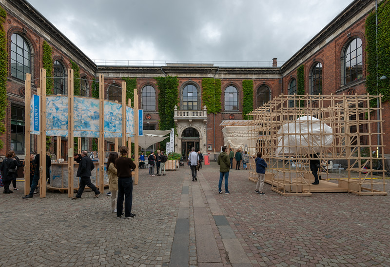 """Art fair being setup. Kunsthal Charlottenborg (""""Charlottenborg Exhibition Hall"""") in Copenhagen, Denmark is the official exhibition gallery of the Royal Danish Academy of Art. The palatial residence was constructed in 1672–83 for Ulrik Frederik Gyldenløve, in the Baroque architectural idiom shared by Holland, England and Denmark. The structure contains an extensive library of the fine arts."""