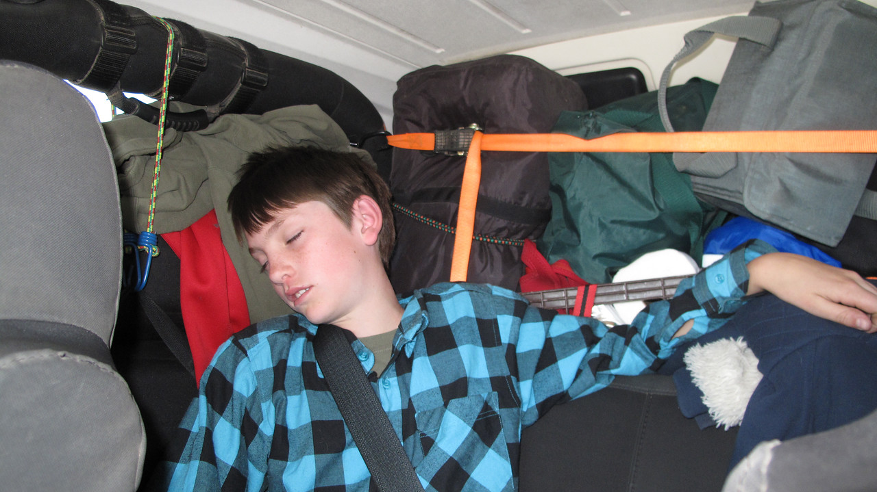 One packed Jeep, and one tired kid, heading home.