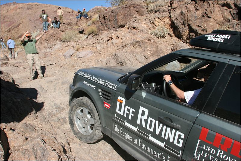 Adam's Range Rover Sport makes it up the wall easily.  Nathan in the background spotting for Adam.